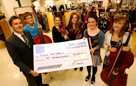 NYO players accept the Grant Cheque