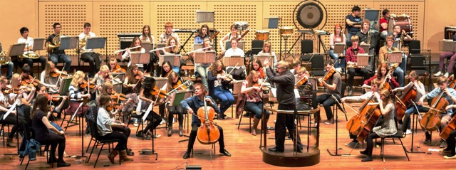 NYO rehearsing with Julian Lloyd Webber on stage at the Royal Concert Hall